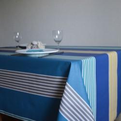 Tissu enduit ou toile enduite au mètre avec des rayures colorées sur fond bleu