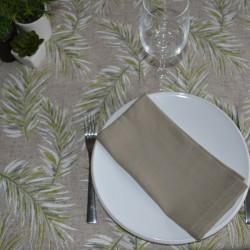 Nappe en toile enduite avec un motif de feuilles tropicales sur fond lin