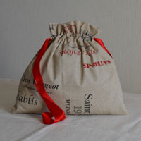 Pochette ou trousse en tissu ou toile enduite