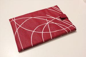 Housse de liseuse numérique en tissu ou toile enduite réalisée et confiée par Yibing