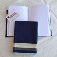 Protège cahier en toile enduite ou tissu enduit